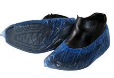 在白色背景隔绝的起动的鞋子盖子 库存照片