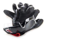 在白色背景隔绝的运作的手套保护玻璃 免版税库存照片