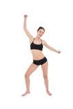 在白色背景隔绝的运动的少妇跳舞 图库摄影