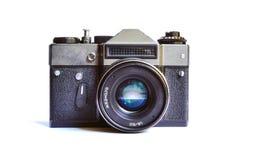 在白色背景隔绝的逗人喜爱的苏联减速火箭的影片照相机 免版税库存图片