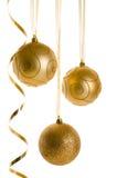 在白色背景隔绝的金黄圣诞节装饰品 库存图片