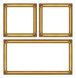 在白色背景隔绝的集合金黄框架,与截去pa 免版税库存照片