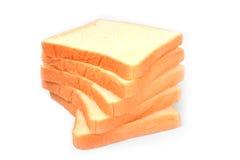 在白色背景隔绝的鲜美堆面包 库存照片
