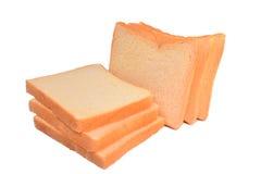 在白色背景隔绝的鲜美堆面包 免版税库存照片