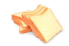在白色背景隔绝的鲜美堆面包 免版税库存图片