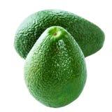 在白色背景隔绝的整个成熟鲕梨 两新绿色 免版税库存照片