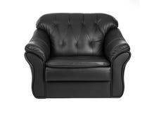 在白色背景隔绝的经典大黑皮革扶手椅子 免版税库存照片