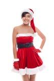 在白色背景隔绝的年轻圣诞节女孩微笑 库存照片