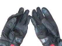 在白色背景隔绝的黑手套摩托车 免版税库存照片