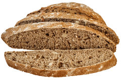 在白色背景隔绝的黑暗的缺一不可的Multigrain面包切片 库存图片