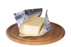 在白色背景隔绝的黄油 免版税库存照片