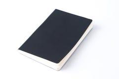 在白色背景隔绝的黑皮革笔记本 库存照片