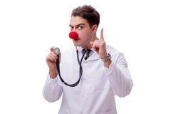 在白色背景隔绝的滑稽的小丑医生 图库摄影