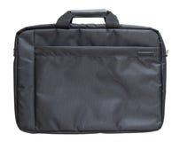 在白色背景隔绝的黑膝上型计算机袋子 免版税库存照片
