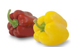 在白色背景隔绝的黄色和红辣椒 库存照片