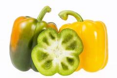 在白色背景隔绝的黄色和青椒有些菜  免版税库存照片