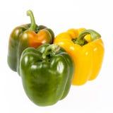 在白色背景隔绝的黄色和青椒菜  库存照片
