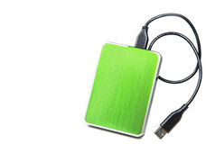 在白色背景隔绝的绿色外在硬盘 免版税图库摄影