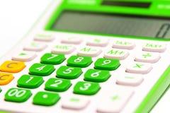 在白色背景隔绝的绿色数字式计算器 免版税图库摄影