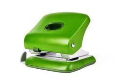 在白色背景隔绝的绿色新的办公室纸打孔器 库存照片