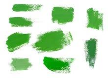 在白色背景隔绝的绿色油漆冲程 免版税库存照片