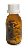 在白色背景隔绝的黄色药瓶 库存照片