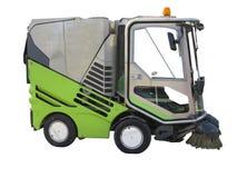 在白色背景隔绝的绿色道路清扫工机器 免版税库存图片