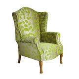 在白色背景隔绝的绿色织品胳膊椅子 免版税库存照片