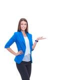 在白色背景隔绝的画象年轻女商人指向 库存照片