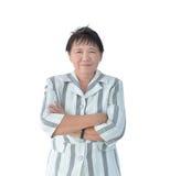 在白色背景隔绝的年长亚洲女商人微笑 免版税库存图片