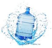 在白色背景隔绝的水飞溅的大水瓶 免版税图库摄影