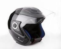 在白色背景隔绝的黑,发光的摩托车盔甲 免版税库存图片