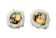 在白色背景顶视图隔绝的两个加利福尼亚卷寿司 免版税库存图片