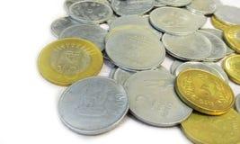 在白色背景3的硬币 图库摄影