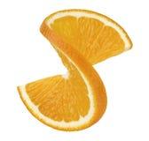 在白色背景2隔绝的橙色扭转的切片 库存照片