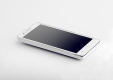 在白色表面特写镜头的白色巧妙的电话 免版税库存图片