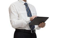在白色衬衣的商人有片剂的 免版税库存照片