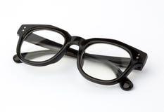 在白色被折叠隔绝的黑眼睛玻璃 免版税库存照片