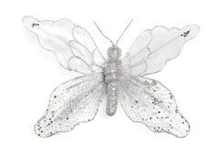 在白色被隔绝的backgroun的圣诞装饰发光的蝴蝶 库存图片