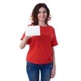 在白色被隔绝的背景的微笑的少妇 免版税库存照片