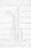 在白色设计和木背景的愉快的复活节贺卡 免版税库存图片