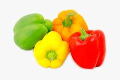 在白色返回查出的不同地色的甜椒的混合 库存图片