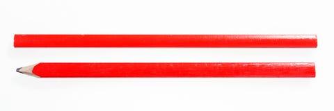 在白色隔绝的两支红色建筑铅笔 免版税库存照片