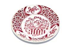 在白色隔绝的古色古香的陶瓷碗筷 免版税库存图片