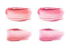 在白色隔绝的套另外嘴唇光泽污迹 被弄脏的ma 免版税库存照片
