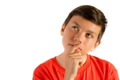 在白色隔绝的年轻十几岁的男孩 免版税库存图片