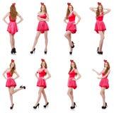 在白色隔绝的微型桃红色礼服的相当年轻模型 免版税库存图片