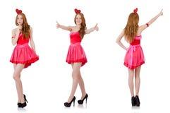 在白色隔绝的微型桃红色礼服的相当年轻模型 库存照片