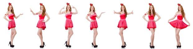 在白色隔绝的微型桃红色礼服的相当年轻模型 免版税图库摄影