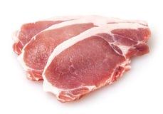 在白色隔绝的未加工的猪肉 免版税库存照片